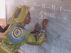 au-education-litterate-woman-writing-on-blackboard2-2013.jpg