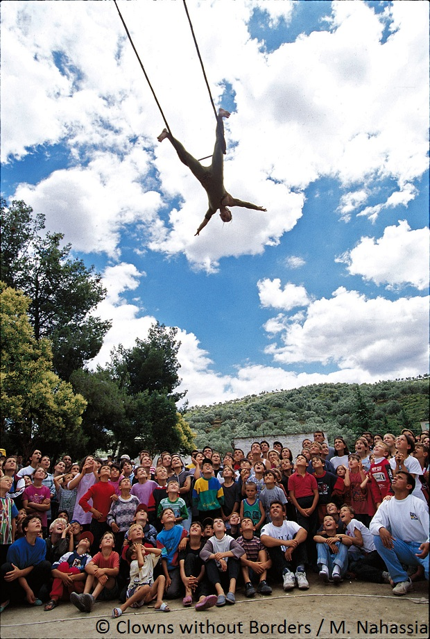 Acrobat swinging above an audience
