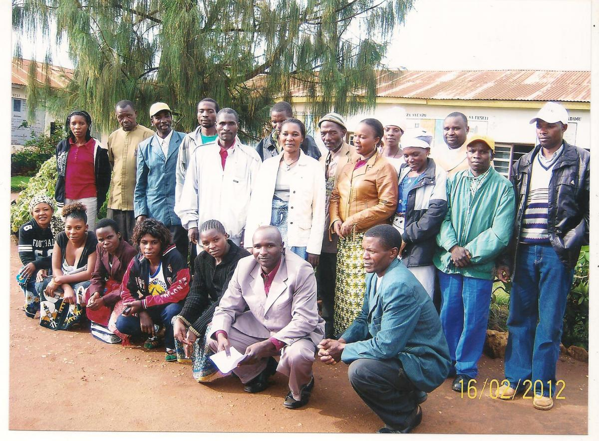Paulina Samata poses with local teachers, government officers, members of a local school's parent board and friends