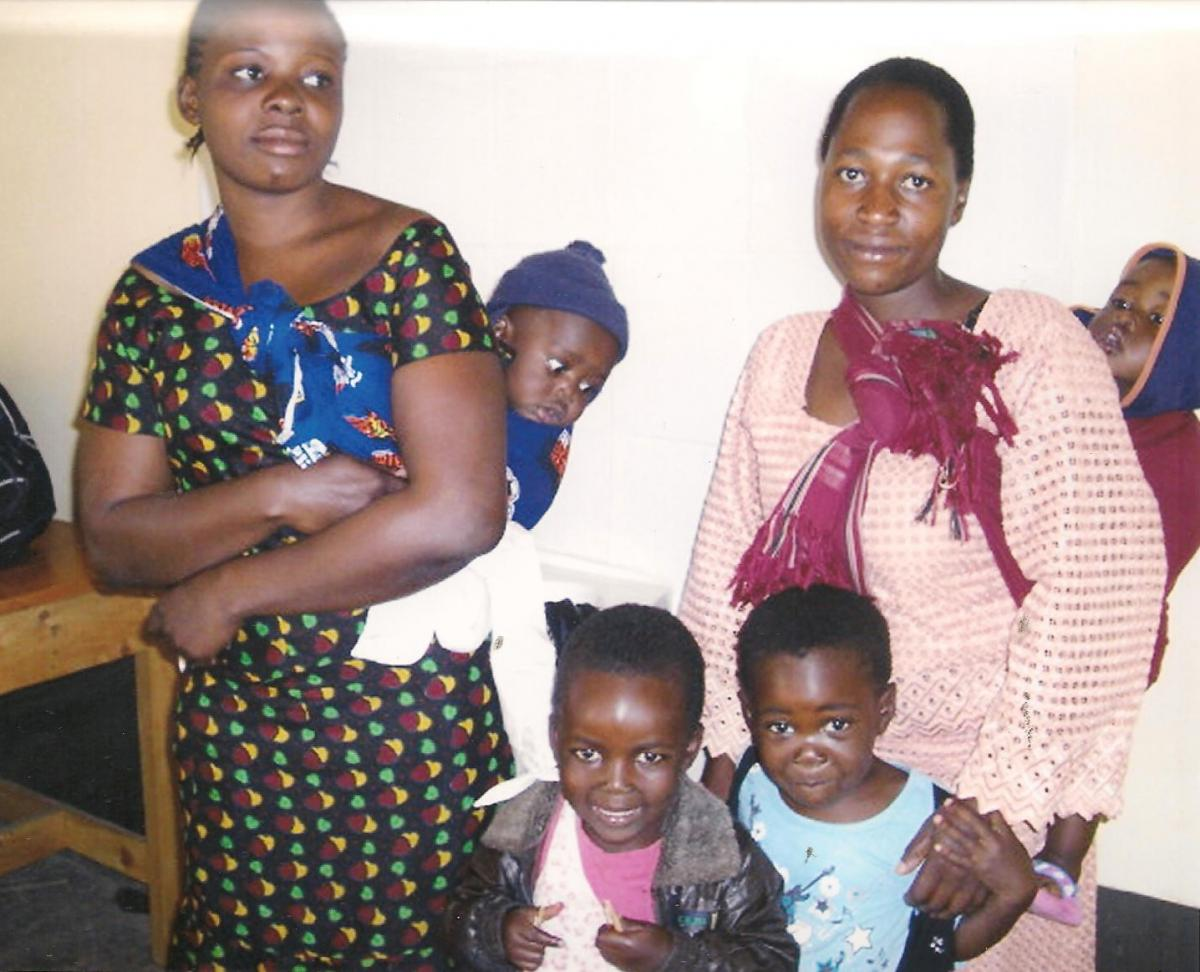 Women of the Mbeya Bamboo Women's Group with their children