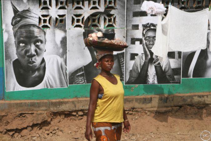 Woman carries belongings on her head in Sierra Leone