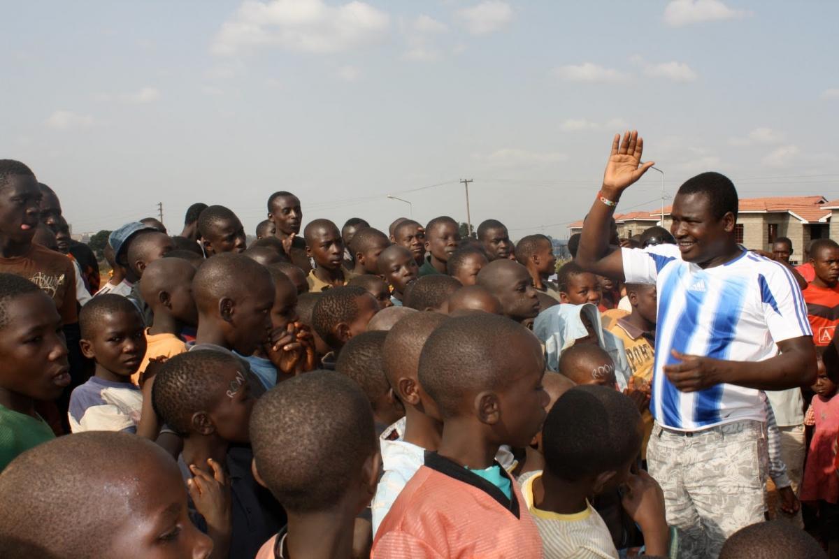 Kennedy Odede of Shining Hope for Communities leads soccer teams in Kibera