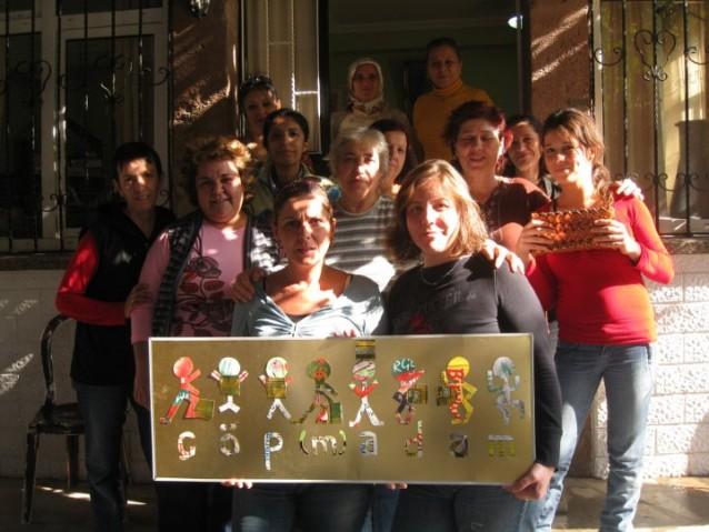 çöp(m)adam's garbage ladies pose together in front of their workshop