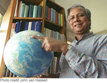 Muhammad Yunus point to Bangladesh on globe