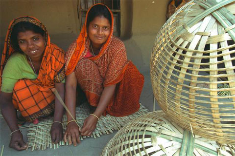 Women weave baskets in Bangladesh