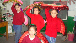Migrant girls perform a traditional dance